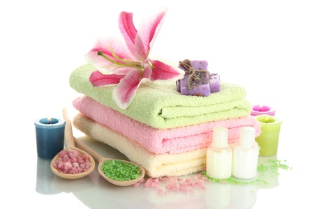 towels with lily, aroma oil,  candles, soap and sea salt isolated on white Stock Photo - 15547819