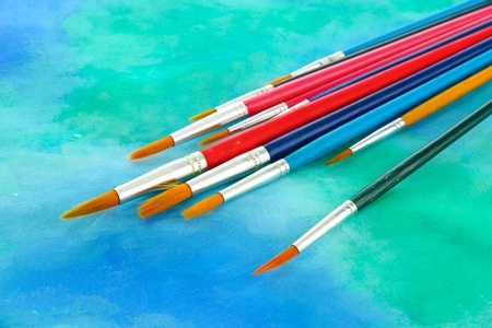 brushes on bright abstract gouache painted background Stock Photo - 15579406