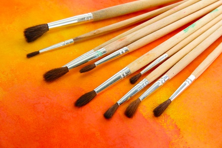 brushes on bright abstract gouache painted background Stock Photo - 15578932