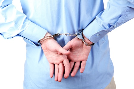 man in handcuffs on white background close-up Stock Photo - 15579385