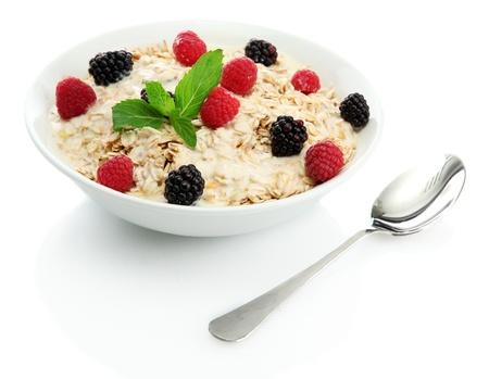 porridge: tasty oatmeal with berries, isolated on white Stock Photo