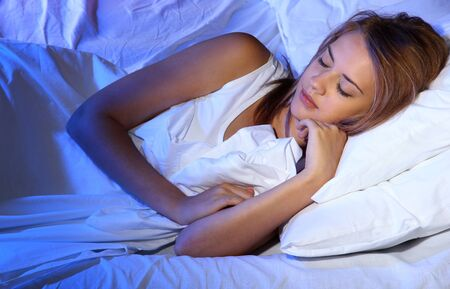 young beautiful woman sleeping on bed in bedroom Stock Photo - 17129697