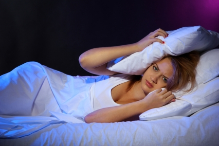 young beautiful woman lying on bed in bedroom photo
