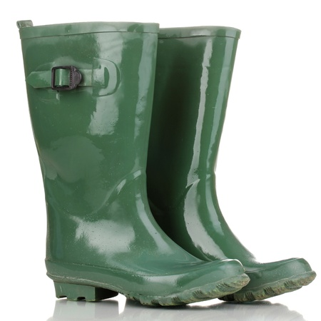 green gumboots isolated on white photo