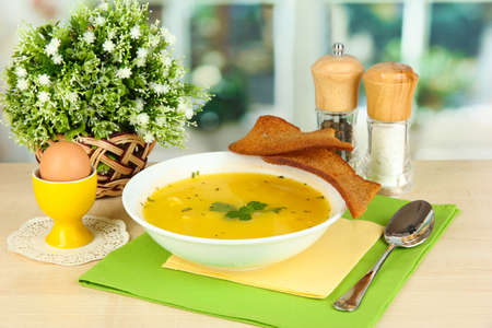 Fragrant soup in white plate on table on window background close-up Stock Photo - 15562566