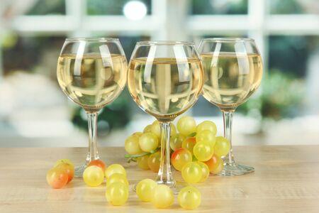 degustation: White wine in glass on window background