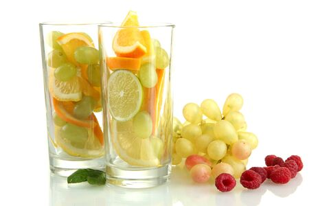transparent glasses with citrus fruits, isolated on white Stock Photo - 15545726
