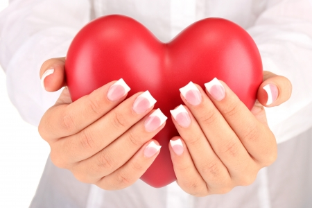 Red heart in woman's hands, on white background close-up Stock Photo - 15545533