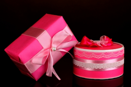 Colorful pink gifts on orange background photo