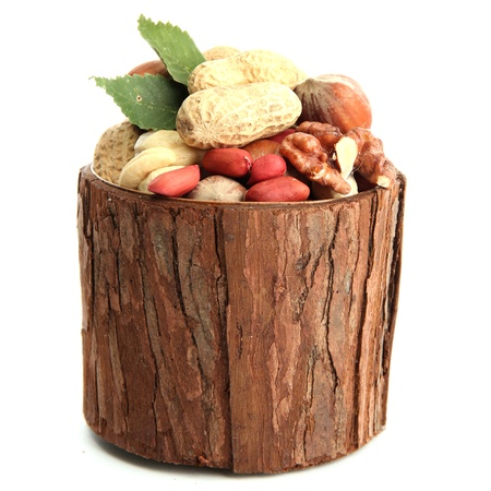 assortment of tasty nuts with leaves in wooden vase, isolated on white Stock Photo - 15545878