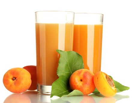 two glasses of apricot juice and apricots with leaves isolated on white Stock Photo - 15579974