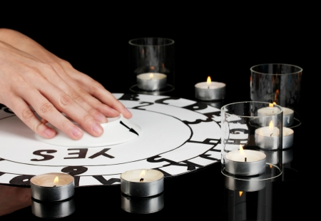soothsayer: spiritualistic seance by candlelight close-up