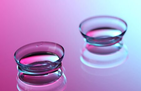 shortsightedness: contact lenses, on pink-blue background