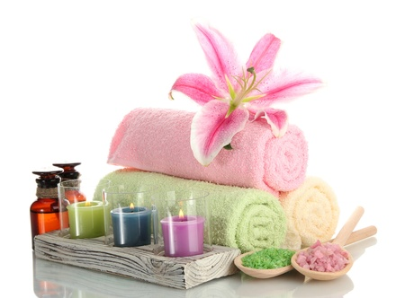 towels with lily, aroma oil,  candles and sea salt isolated on white Stock Photo - 15643272