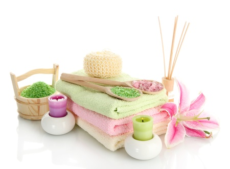 towels with lily, aroma oil,  candles and sea salt isolated on white Stock Photo - 15643210