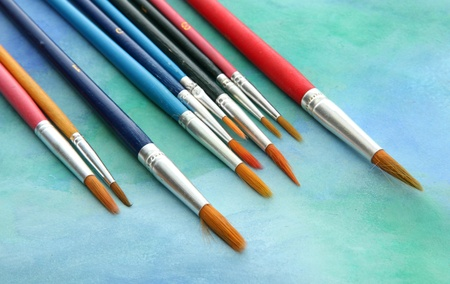 brushes on bright abstract gouache painted background Stock Photo - 15661551