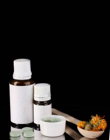 Alternative therapies on the tray on black background close-up Stock Photo - 15642646