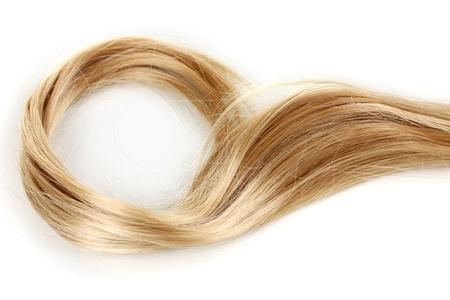textura pelo: El pelo rizado rubio close-up aislados en blanco Foto de archivo