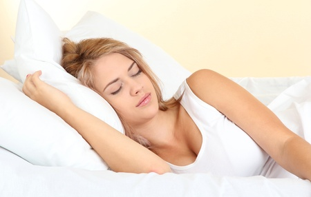 young beautiful woman sleeping on bed in bedroom Stock Photo - 17187002