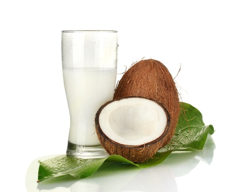 glass of coconut milk and coconuts isolated on white Stock Photo - 15643101