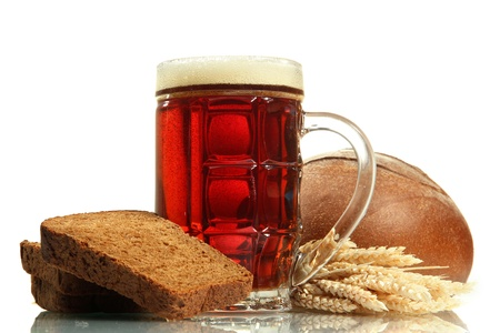 unbottled: tankard of kvass and rye breads with ears, isolated on white