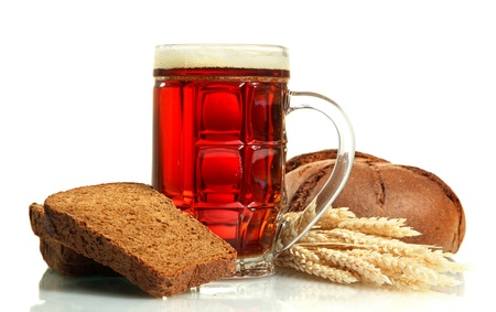 tankard of kvass and rye breads with ears, isolated on white photo
