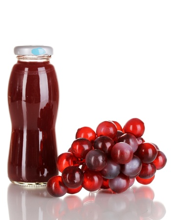 Delicious grapes juice in glass bottle and pink grapes next to it isolated on white Stock Photo - 15643042