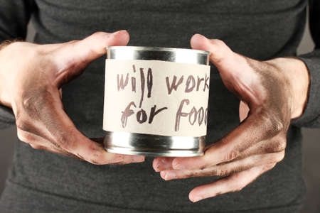 waif: homeless man asks for help, on black background close-up Stock Photo