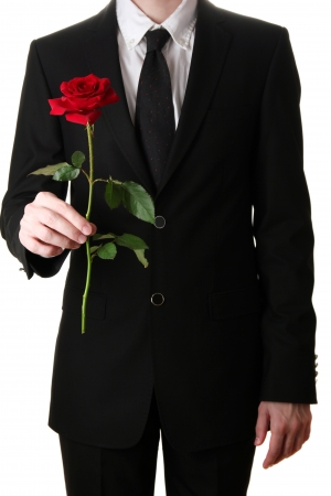 man holding rose close-up photo