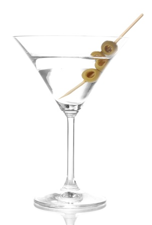Martini glass and olives isolated on white photo