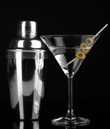 shaker: Martini glass with olives and shaker isolated on black