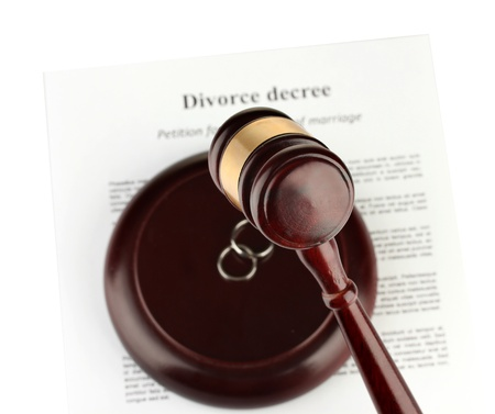 Divorce decree and wooden gavel on white background photo