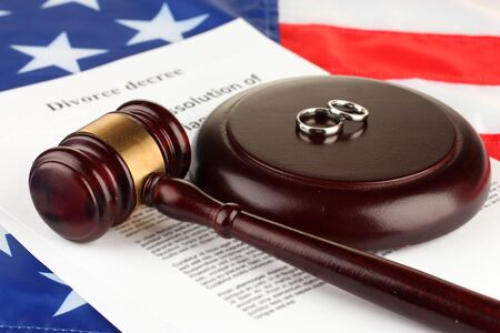 divorce court: Divorce decree and wooden gavel on american flag background