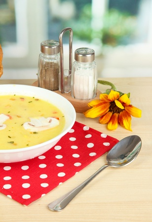 Fragrant soup in white plate on table on window background close-up Stock Photo - 15643859