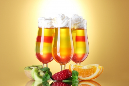fruit jelly in glasses and fruits on yellow background Stock Photo - 15643854