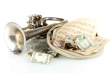 jobless: musical instrument with money isolated on white