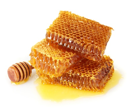 honey comb: sweet honeycomb and wooden drizzler, isolated on white