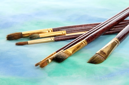 brushes on bright abstract gouache painted background Stock Photo - 15689147