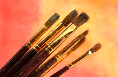 brushes on bright abstract gouache painted background Stock Photo - 15689260
