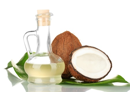 decanter with coconut oil and coconuts isolated on white Stock Photo - 15688688