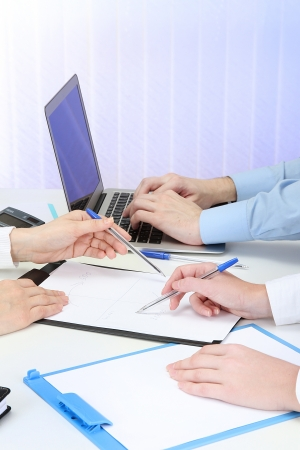 close up of business people hands during teamwork photo