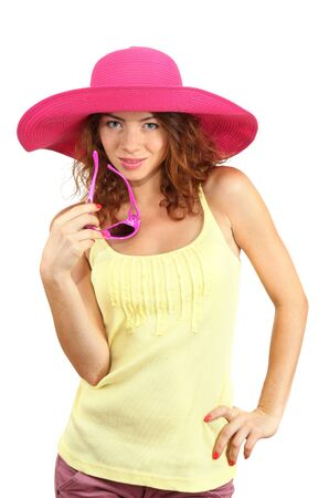 Smiling beautiful girl with beach hat and glasses isolated on white photo