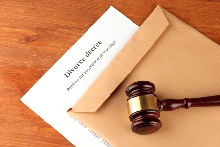 decree: Divorce decree and envelope on wooden background