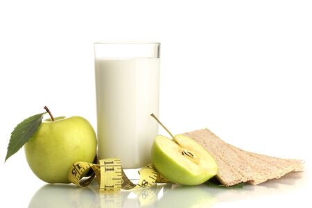 Glass of kefir, green apples, crispbreads and measuring tape isolated on white Stock Photo - 15662172