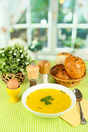 Fragrant soup in white plate on green tablecloth on window background close-up Stock Photo - 15689347