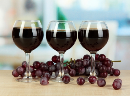 degustation: Red wine in glass on room background Stock Photo
