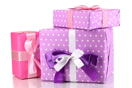 three gift boxes: Colorful purple and pink gifts isolated on white