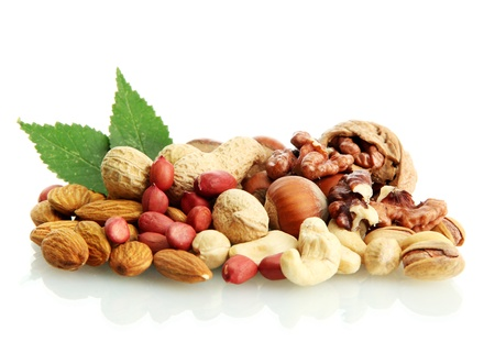 assortment of tasty nuts with leaves, isolated on white Stock Photo - 15688680