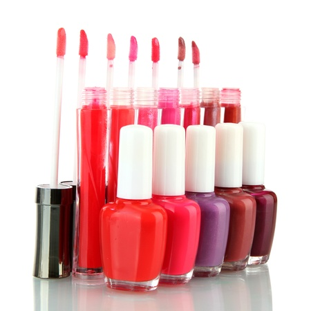 beautiful lip glosses and nail polish bottles, isolated on white Stock Photo - 15690041