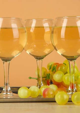 degustation: White wine in glass on salver on beige background Stock Photo
